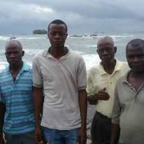 Eric EL2EF in centre with village chief to his right. Behind Eric is Telengbe Island.
